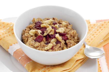 oatmeal: Bowl of oatmeal with dried fruit and nuts.