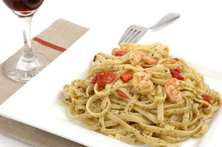 fettuccine: Fettuccine with pesto roasted peppers and shrimp.