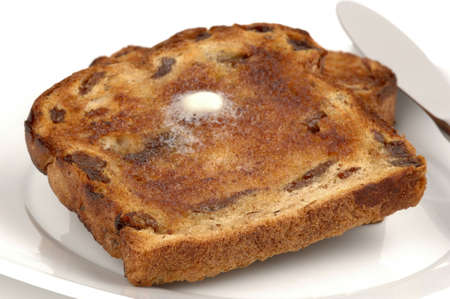 browned: Toasted and buttered raisin bread perfectly browned. Stock Photo