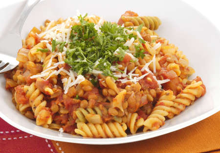 Rotini with plum tomato and lentil sauce. Imagens - 2467304