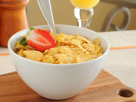 Bowl of crunch corn flakes with strawberries.