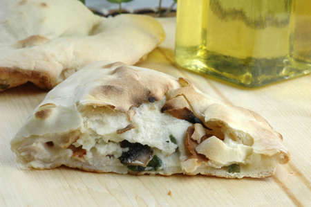 Fresh baked cheese and mushroom calzone. Stock Photo