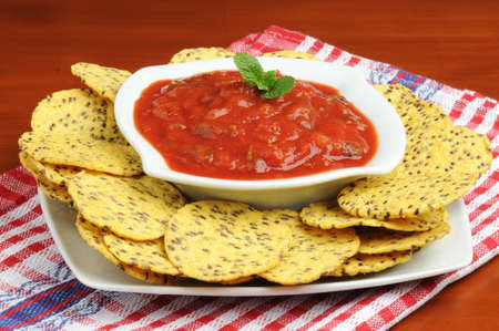 White bowl of fresh salsa served with tortilla chips. photo