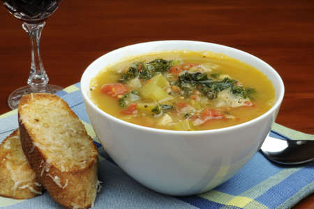 crusty: Bowl of homemade vegetable soup with crusty bread.