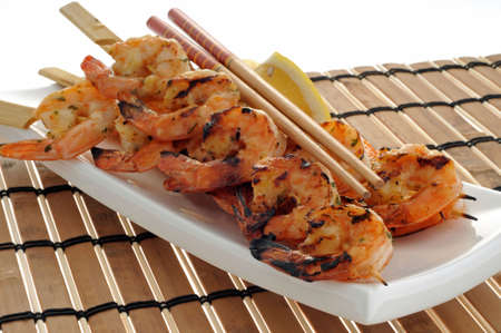 wedges: Delicious grilled shrimp served with lemon wedges.