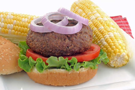 Delicious hamburger served with sweet corn.