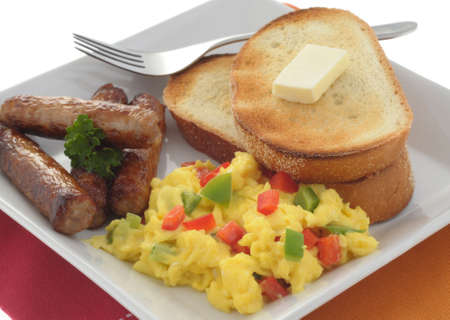 scrambled: Hearty breakfast of scrambled eggs and sausage. Stock Photo