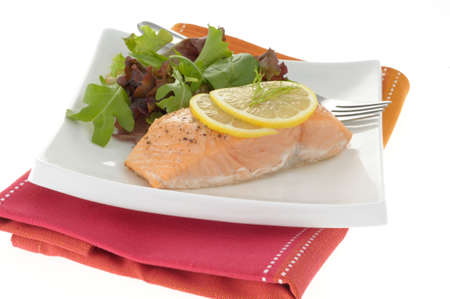 Poached salmon served with fresh greens and lemon. Imagens - 3281189