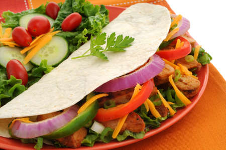 Delicious chicken fajitas served with a fresh salad. photo