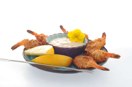 served: Coconut shrimp served with a dipping sauce.