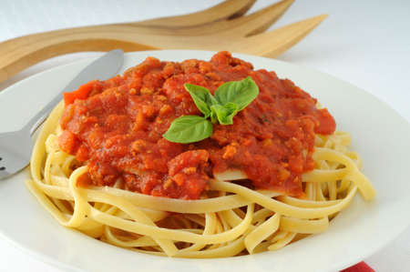 meatless: Linguine pasta with a tasty tomato basil sauce. Stock Photo