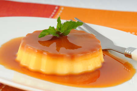 Delicious creme caramel with a sprig of mint.
