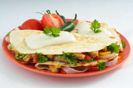 Delicious and tasty cheese and chicken quesadillas. Imagens