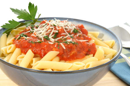 Penne pasta with fresh homemade tomato sauce. Stok Fotoğraf