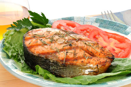 Salmon steak grilled to perfection with fresh vegetables.