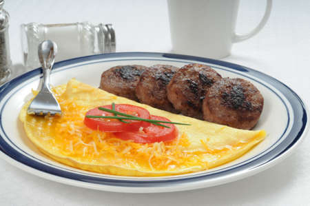 Cheddar cheese omelet served with pork sausage.