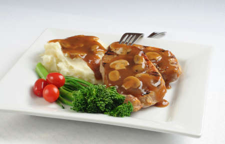Pork chops potatoes and vegetables with mushroom gravy. Imagens - 3570293