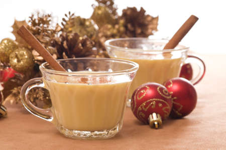 Glasses of festive eggnog with christmas decorations. photo