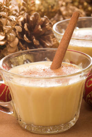 Festive eggnog served with a cinnamon stick.