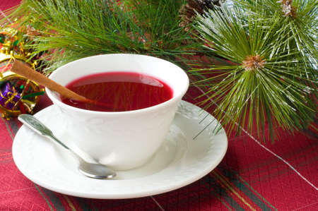 Cup of hot cranberry tea especially brewed for christmas,