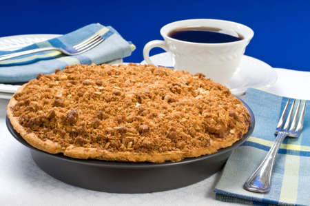 Fresh baked apple crumble pie and coffee.