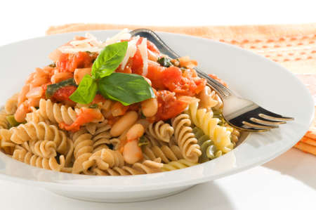 Bowl of rotini pasta with a homemade tomato and bean sauce. Zdjęcie Seryjne