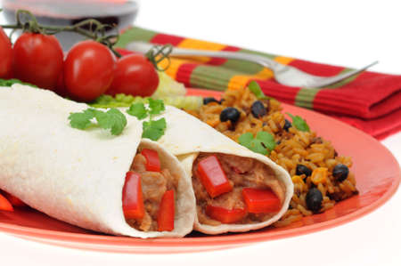 burrito: Delicious bean burrito served with mexican style rice. Stock Photo