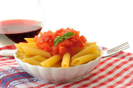 Fresh penne pasta with tomato and basil sauce.