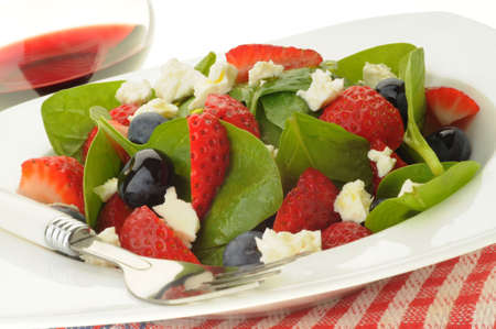 Fresh green salad with berries and feta. Imagens - 5119190