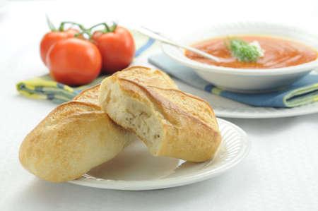 Fresh baked bread served with hot soup. Reklamní fotografie