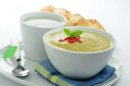 Bowl of homemade broccoli soup with green tea. Stock Photo - 5299870