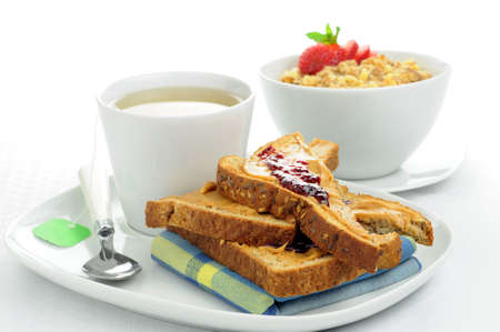 Breakfast of toast and cereal served with tea. photo