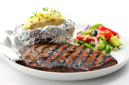 Grilled steak with baked potatoes and salad. Imagens - 5343985