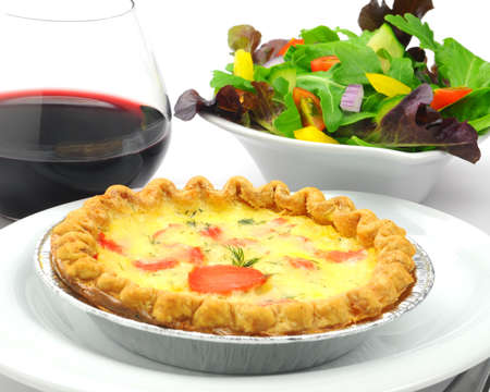 Smoked salmon and herb quiche with a salad. Stock fotó