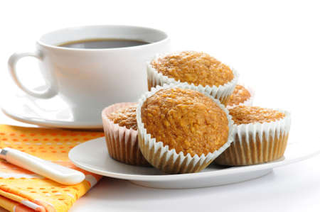 Plate of homemade oatmeal muffins served with coffee.
