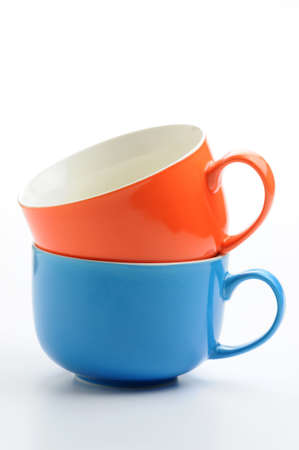 Two colorful ceramic mugs stacked.