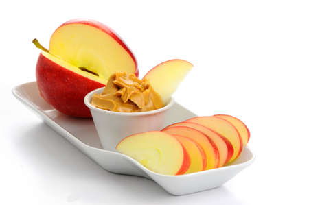 snack: Snack consisting of ripe apple and peanut butter.