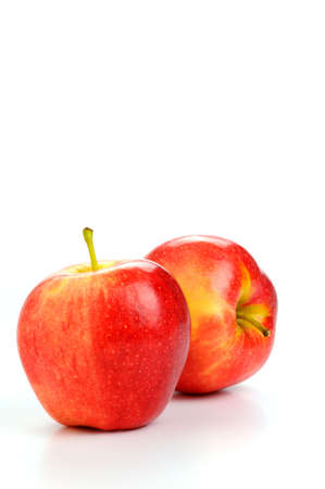 Fuji apples on a white background with copy space.