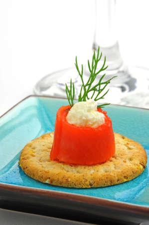 creamed: Tasty smoked salmon wrapped around creamed cheese. Stock Photo