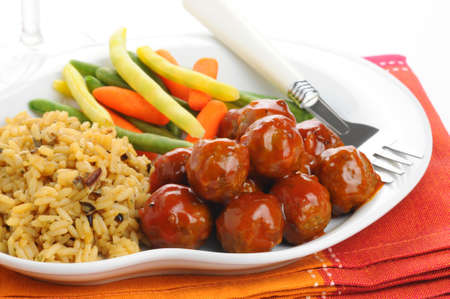 Swedish meatballs served with wild rice and vegetables. Stock fotó