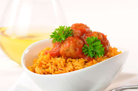 Meatballs and tomato sauce served on rice.