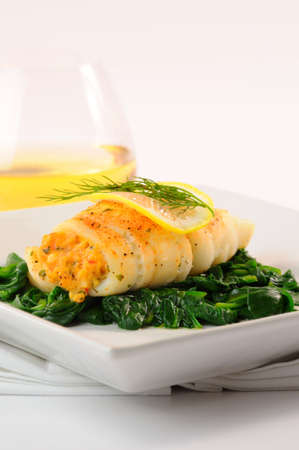 stuffed fish: Delicious dinner of sole stuffed with crab. Stock Photo