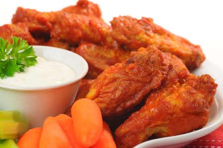 hot sauce: Spicy hot buffalo chicken wings shot closeup.