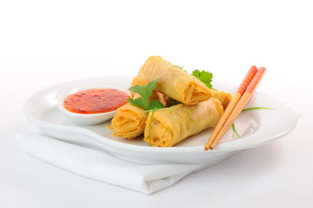 Delicious spring rolls with a spicy thai dipping sauce. Stock Photo - 6250057