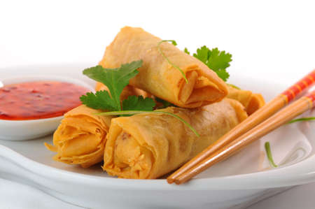 Delicious thai spring rolls with spicy pepper sauce. photo