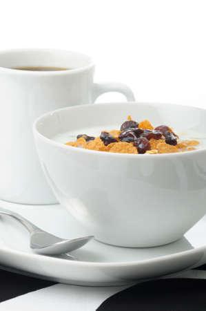 Bowl of healthy high fiber cereal with coffee. Banco de Imagens