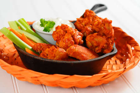 hot wings: Buffalo style chicken wings and fresh vegetables.