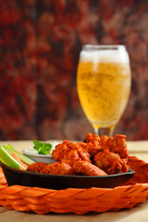 chicken fingers: Buffalo style chicken wings served with cold beer.