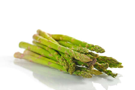 Fresh raw asparagus shot on a white background.
