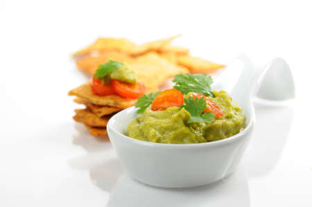 Fresh homemade guacamole served with backed chips.